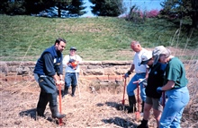 Glenn Page instructs volunteers in planting techniques. Scott Gudes of NOAA isin the background.
