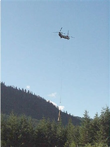 A Boeing Verto 107 helicopter was used to lift logs into place in the stream.