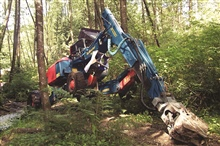 The second in a series of images that show the specialized spyder at work atthe Glade Bekken restoration site. The spyder was used at the restoration siteto prevent and minimize disturbance to the habitat. The machine crawls and walksover the surface