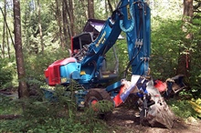 The third in a series of images that show the specialized spyder at work atthe Glade Bekken restoration site. The spyder was used at the restoration siteto prevent and minimize disturbance to the habitat. The machine crawls and walksover the surface