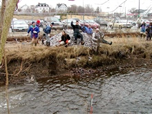 Cobble habitat is tossed into North River to replace storm water sedimentson the river bottom.