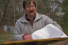 A surveyor reads the chart that tells him exactly where the historical dam thatis scheduled for removal is located.