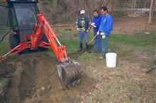 Breaking ground at the dam removal site to test soil for contaminants.