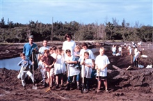 A group of boy scouts and their leaders plant native wetland plantsin Palmetto, Manatee County, Florida.