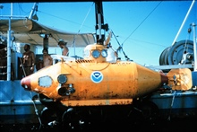 NEKTON GAMMA slung to the side of the support ship.