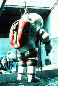 JIM, a One-Atmosphere Armored Dive Suit (OMADS).