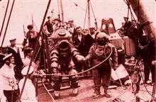 J. Peress' 1-atm dive suit, Tritonia, explored the Lusitania wreck in 1935. JimJarrett was Peress's chief diver and made this dive to 312 feet. This suitwas a precursor to the Jim suit, named for Jim Jarrett.