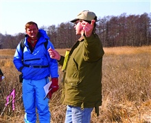 Eric Hutchins, NOAA, discusses restoration alternatives with a group ofpotential contractors and restoration partners.