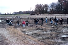 Volunteers in the emergent wetland, vegetation in the flood plain.