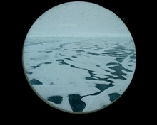 View of Arctic ice through one of Healy's portholes.