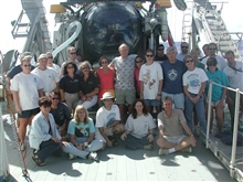 The science team aboard the R/V Seward Johnson for the third leg of theexpedition from August 16-31, 2002.  The Johnson-Sea-Link submersiblethat was used for each of the 23 dives during the mission, rests behind themon the fantail of the ship.