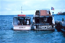 Small boats, rigid hull inflatables, were used to support the restorationeffort. Divers left the Cunan Law, where they were housed and fed, and weretransported to the reef by the tenders.