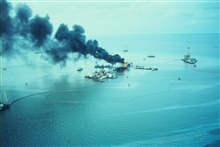 An oil rig blew out spewing crude oil into Timbalier Bay. The rig is surroundeda boom to contain the oil.