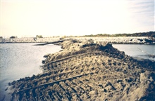 An image showing dredge material that was added to the area in front of theproduction facility. This area had the largest contiguous remaining marsh afterhurricane Andrew passed through. The restoration project conducted with theoil blow out settleme