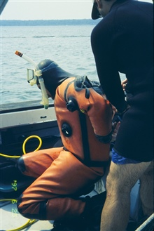 The first in a series of images showing NOAA scientists at the 1997 transplantsite just before transplanting the eelgrass turf. Scientists worked in dry suitsin the cold Bay waters and used surface air supplies at the mostly shallowsites. Zostera mar