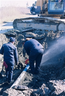 This image shows cutting through a water pipe that allowed workers to continuethe restoration work.