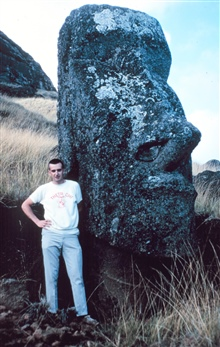 Station Number 020 -  Bob Kulton next to a Moia, one of the famous Easter Island statues. Station Easter geographic coordinates 27 10 36 SouthLatitude.  250 34 23 East Longitude.