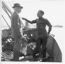 Dr. Harris B. Stewart in wet suit discussing operations of C&GS; ShipGILBERT with Under Secretary of Commerce Allen.