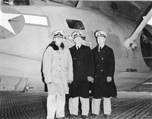 Coast and Geodetic Survey liaison officer to Navy operations in Aleutians withRear Admiral Leo Colbert and Captain Clement Garner on inspection trip ofAlaskan field parties.  They are in front of a Coast Guard PBY that was beingused for C&GS; air pho