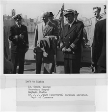 L-R -  Lieutenant Commander Clarence George, Secretary of Commerce Sawyer,Captain Robert Studds, and J.J. Judge, Regional Director of the Department ofCommerce.  On C&GS; Ship BOWIE.