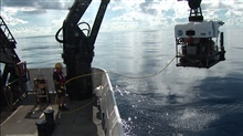 Recovering Deep Discoverer on a glassy smooth day.