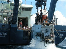 Gulf of Alaska Seamount Expedition. ALVIN being lifted onto the deck of WHOI R/V ATLANTIS by the A-frame, with swimmers Bruce Strickrott and SeanMcPeak (Chief ALVIN pilot and electronics technician respectively) working therecovery.