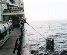 Gulf of Alaska Expedition 2004. The CTD (conductivity, temperature, and depth)rosette is brought back on deck after having taken water samples and a profileof the water column.