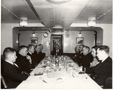 Wardroom of PATHFINDER.  Counter-clockwise - Ens. Trauschke, Ens. Saladin,CME Gilgan, Captain Wennermmark, Captain John Bowie, Commander Whipp at endof table, Mr. Hart, Captain Wardwell, Commander Phillips, Lt. Commander Williams, Ens. Stokes.