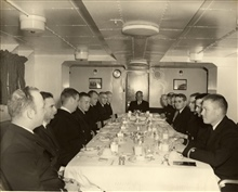 PATHFINDER wardroom - CME Gilgan, left center; Lt. Phil Taetz, right center.