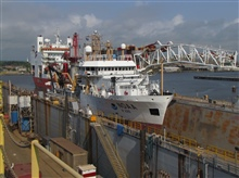 NOAA Ship PISCES in drydock with water pumped out