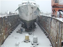 NOAA Ship MILLER FREEMAN in drydock on a snowy winter day.