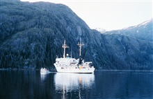 NOAA Ship RAINIER with hydrographic survey launch in Alaska.
