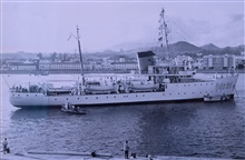 Coast and Geodetic Survey Ship EXPLORER at Punta del Gada, Azores.  Federalbuildings are in the background.