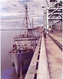 Coast and Geodetic Survey Ship PATHFINDER tied up at Anchorage.  30-foot tidesare common.