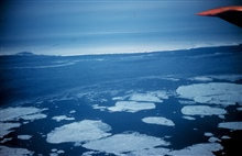 Flying over large tabular icebergs on the way to McMurdo Sound