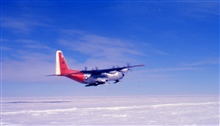 Ski-equipped C-130 on its way back to McMurdo Sound from the South Pole.