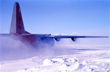 Kicking up a little loose ice and snow during takeoff.The last plane at South Pole Station before the fall sunset