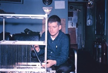 Fred Walton working on scientific equipment at South Pole Station.