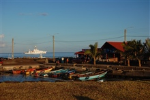 The NOAA Ship RON BROWN off the boat basin at Easter Island.A moai looks inland from the harbor.   All moai look inland.
