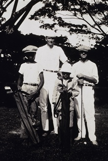 Golf at the Zambo Country Club.L to R - caddy, George L. Anderson, caddy, H. C. Warwick.Off the MARINDUQUE