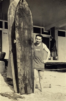 William M. Scaife trying his hand at surfing.A stop at Honolulu on the way out to the Philippines