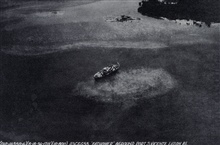 Aerial view of the FATHOMER aground after typhoon of August 15, 1936.Barometer stood at 26.77 inches during passage of eye.Photo #3 of sequence.