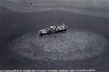 Aerial view of the FATHOMER aground after typhoon of August 15, 1936.Barometer stood at 26.77 inches during passage of eye.Photo #4 of sequence.
