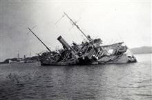 FATHOMER aground after typhoon of August 15, 1936.Barometer stood at 26.77 inches during passage of eye.Photo #5 of sequence.