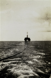FATHOMER being towed to Manila.Barometer stood at 26.77 inches during passage of eye.Photo #9 of sequence.