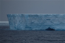 Iceberg with a cave