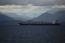 A large cargo vessel transiting the Strait of Magellan