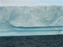 Banding of ice clearly seen in this closeup view of a tabular iceberg.  Thehorizontal bands of ice are similar to stratigraphic layers in rock formationsand can be dated under certain circumstances when the ice is still in place.