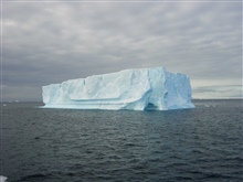 A small tabular iceberg with an ice cave