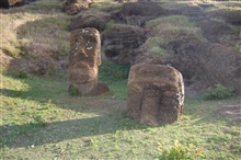 Sphinx-like monolithic moai frozen in place at the Rano Raraku quarry.